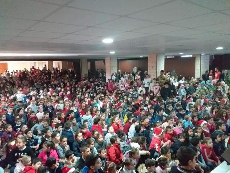بالصور/ كاريتاس اقليم بنت جبيل يقيم حفلا ميلاديا في قاعة كنيسة التجلّي - رميش برعاية الكتيبة الايطالية وتوزيع هدايا على أكثر من ألف طفل