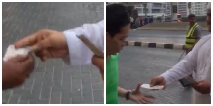 بالفيديو/ شخصان يوزعان أوراق نقدية على المارة في دبي.. والشرطة تحقق