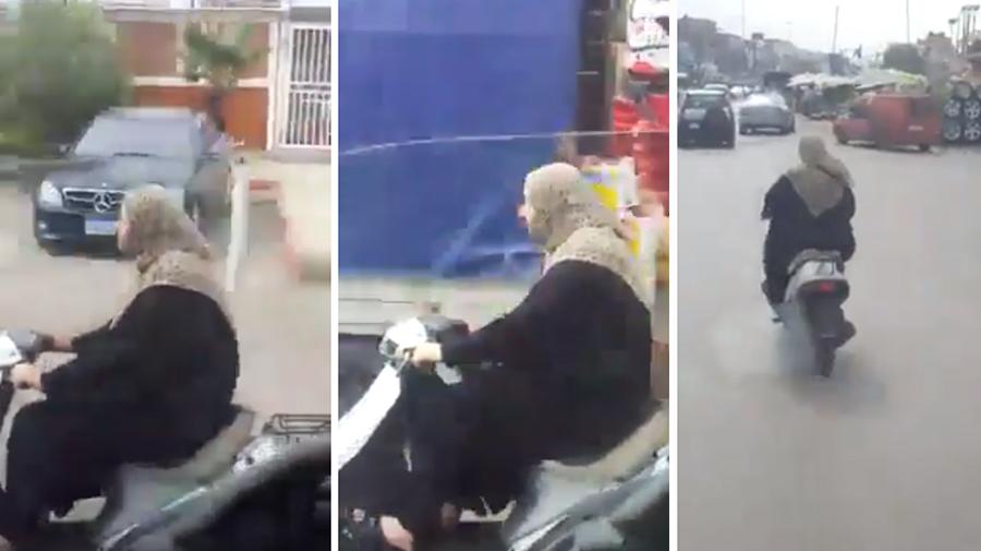 """""""من أخطأ؟"""" شاهدوا واحكموا...سيدة على متن دراجة نارية وشاب يلاحقها بكاميرا هاتفه """"يا زينب...يا فاطمة...مين معلمك السواقة""""!"""